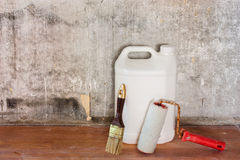 Repairing room old concrete wall, dirty brown floor and tools Royalty Free Stock Image