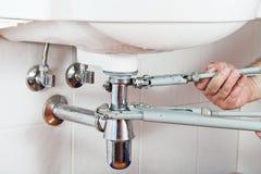Repairing sink drain Stock Photo