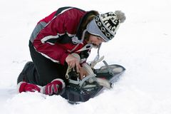Repairing of ski-binding. Girl with screwdriver and snowboard. Repairing of ski-binding Royalty Free Stock Images
