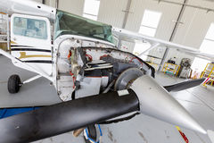 Repairing small propeller airplane Stock Photos