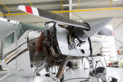 Repairing small propeller airplane Stock Images