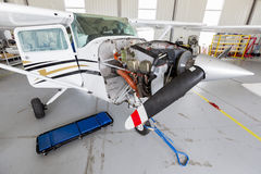 Repairing small propeller airplane Royalty Free Stock Photo