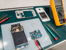 Repairing Smart Phone on Desk Royalty Free Stock Image