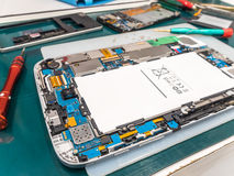 Repairing Tablet and Smart Phone on Desk Stock Image