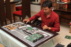 Repairing a television. Electronic engineer repair faulted television stock photos