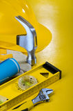 Repairing tools on yellow background Stock Photos