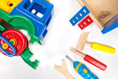 Repairing toy train with toy toolset. Repairing toy train with toy tool set. Symbolizing craftsmanship tendencies starting at the early age Royalty Free Stock Images