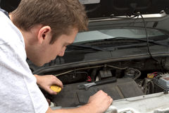 Repairing under car hood Stock Photo