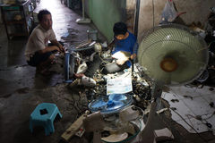 Repairing the used goods. The technician was repairing secondhand goods for resale in the city of Solo, Central Java, Indonesia stock images