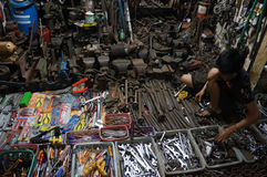 Repairing the used goods. The technician was repairing secondhand goods for resale in the city of Solo, Central Java, Indonesia stock image