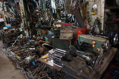Repairing the used goods. The technician was repairing secondhand goods for resale in the city of Solo, Central Java, Indonesia royalty free stock photography