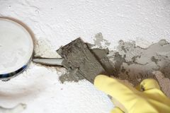 Repairing wall. By putty knife Stock Photography