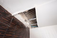 Repairing a water leak damaged ceiling royalty free stock photo