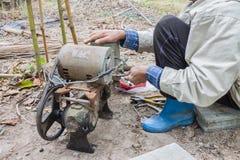 Repairing the water pump. Royalty Free Stock Images