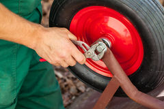 Repairing a  wheelbarrow Royalty Free Stock Photography