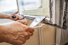 Repairing a window frame Stock Photos
