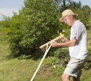 Repairing wooden rake in the garden Stock Images