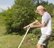 Repairing wooden rake in the garden Stock Images