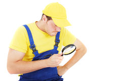 Repairman. Worker repairman with hand glass Stock Images