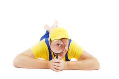 Repairman. Worker repairman with hand glass Royalty Free Stock Photography