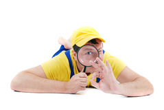 Repairman. Worker repairman with hand glass Royalty Free Stock Photo