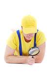 Repairman. Worker repairman with hand glass Royalty Free Stock Image