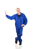 Repairman against the wall Royalty Free Stock Image