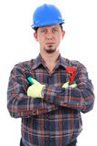 Repairman with arms crossed. On the white background. Isolated on white royalty free stock photos