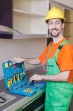 Repairman assembling the furniture Royalty Free Stock Photo
