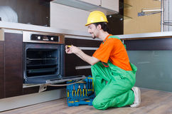 Repairman assembling the furniture Royalty Free Stock Photo