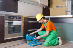 Repairman assembling the furniture Royalty Free Stock Image