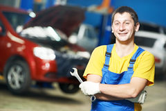Repairman auto mechanic at work Royalty Free Stock Image