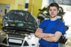 Repairman auto mechanic at work Stock Photography