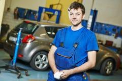 Repairman auto mechanic at work Royalty Free Stock Photos
