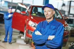 Repairman auto mechanic at workshop Royalty Free Stock Photos