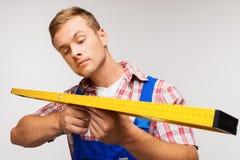 Repairman with builder level Stock Photos