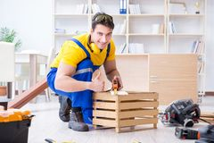 Repairman carpenter working with wooden board plank and measurin. G tape royalty free stock images