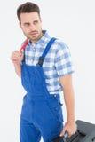 Repairman carrying toolbox while looking asway Stock Photo