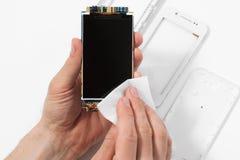 Repairman cleaning smartphone screen Stock Image