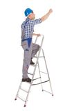 Repairman climbing step ladder Royalty Free Stock Photography