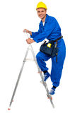 Repairman climbing up a stepladder. With tool box wrapped around his waist Royalty Free Stock Photo