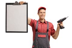 Repairman with a clipboard and a drill machine. Isolated on white background royalty free stock image