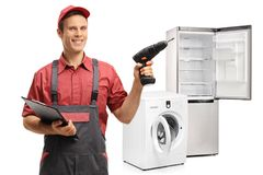 Repairman with a clipboard and a drilling machine Royalty Free Stock Images
