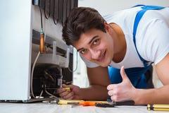The repairman contractor repairing fridge in diy concept Royalty Free Stock Photo