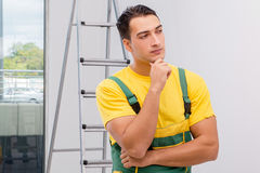 The repairman in coveralls in diy concept Royalty Free Stock Photo