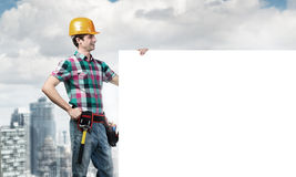Repairman demonstrating banner Royalty Free Stock Image