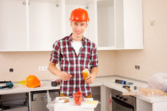 Repairman dines royalty free stock photos