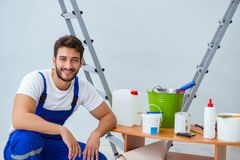 Free Repairman Doing Renovation Repair In The House With Paper Wallpa Stock Photo - 105425530