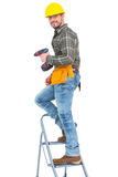 Repairman with drill machine climbing ladder. On white background Royalty Free Stock Image