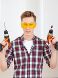Repairman with a drill and a screwdriver Stock Images